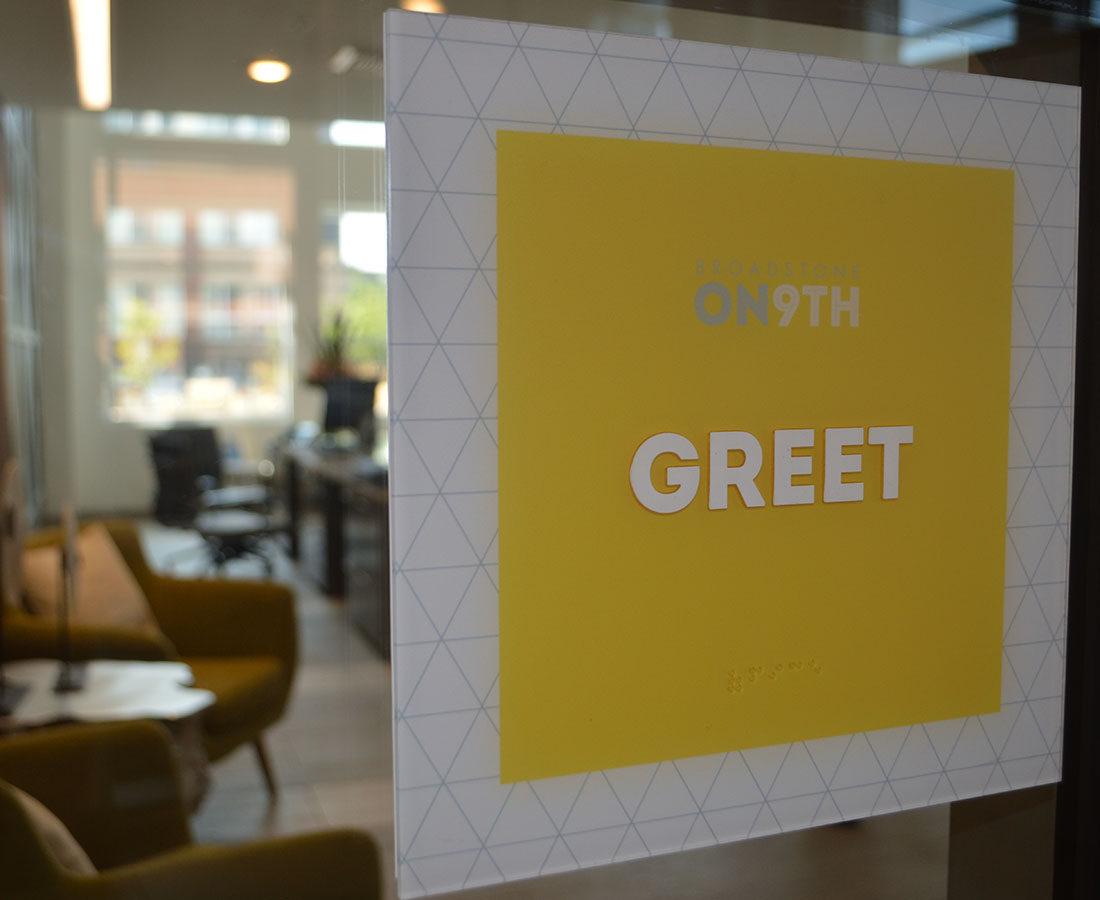 Broadstone on 9th ADA room ID sign yellow greet