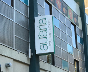 Auraria Student Lofts blade sign day time exterior sign