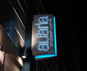 Auraria Student Lofts blade illuminated night time exterior sign