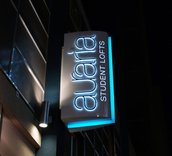 Auraria Student Lofts blade illuminated night time exterior sign