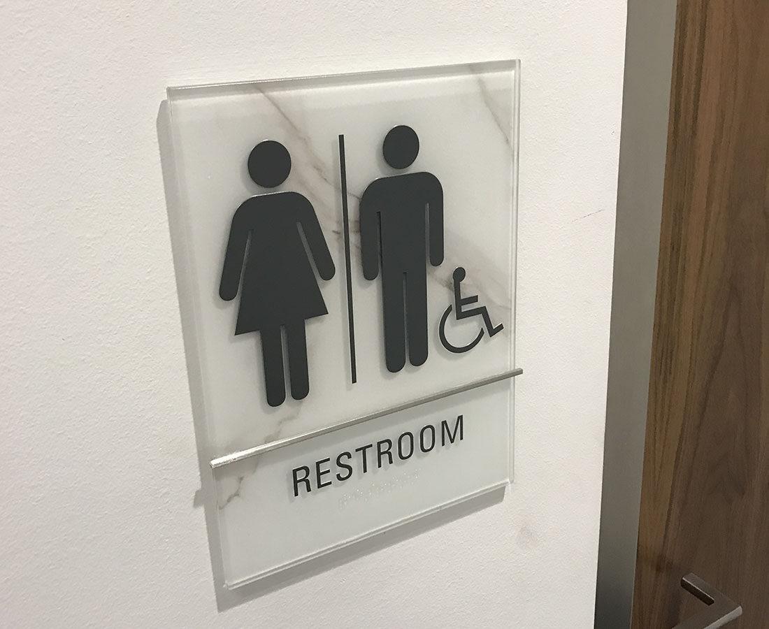 1401 Lawrence glass restroom sign