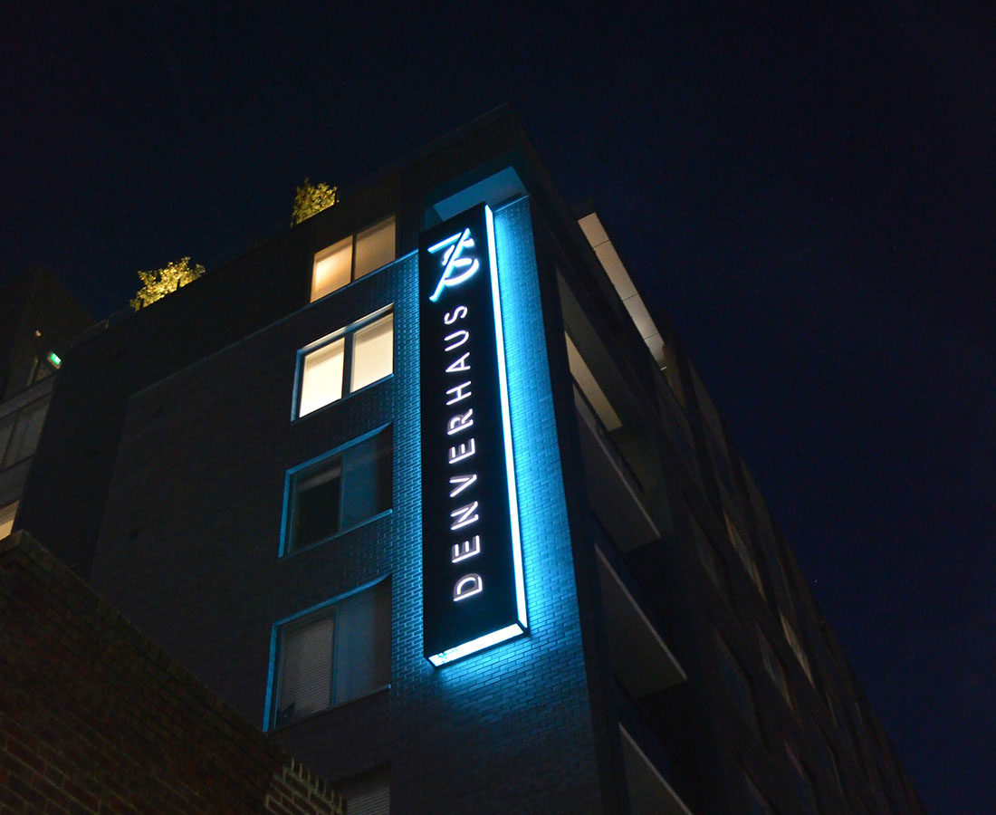 7S Denver Haus wall sign illuminated night time