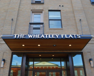 The Wheatley Flats entry canopy sign