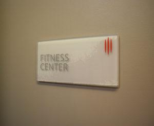 Coda Apartments Glass ADA Room Sign Fitness Center