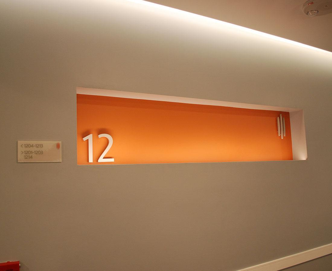 Coda Apartments Floor Identification sign orange