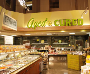 Whole Foods Cherry Creek aged and cured sign