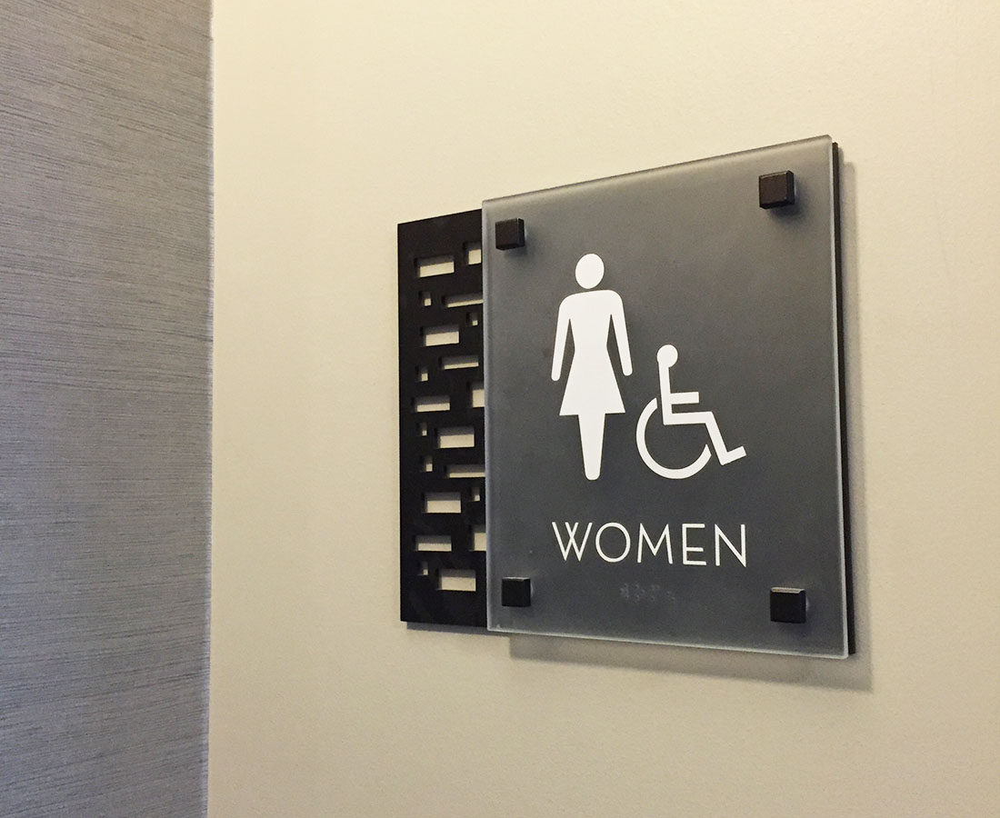 Ovation Apartments restroom sign