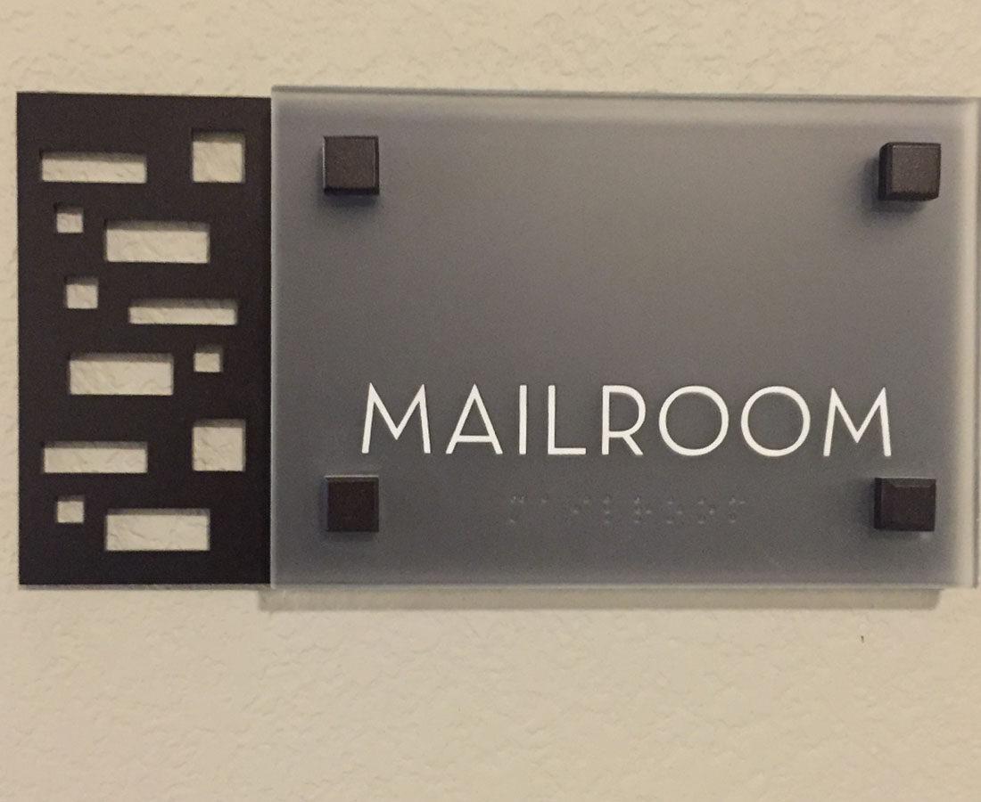 Ovation Apartments mailroom sig