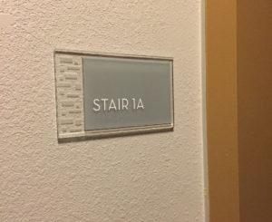 Ovation Apartments glass room ID