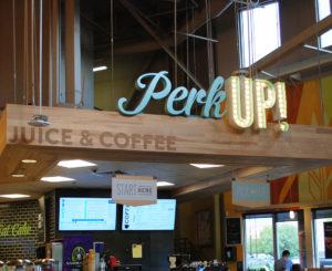 Whole Foods Cherry Creek perk up sign illuminated