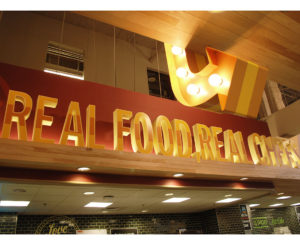Whole Foods Cherry Creek real food real chefs, illuminated arrow sign
