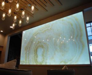Interior custom glass light wall at Solana Olde Town Station