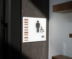 Solana Lucent Station glass restroom ID sign