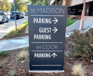 55 Madison and 44 Cook parking directional monument