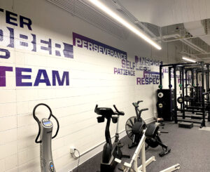 Purple vinyl wall graphics at the Colorado Rockies Clubhouse fitness center at Coors Field