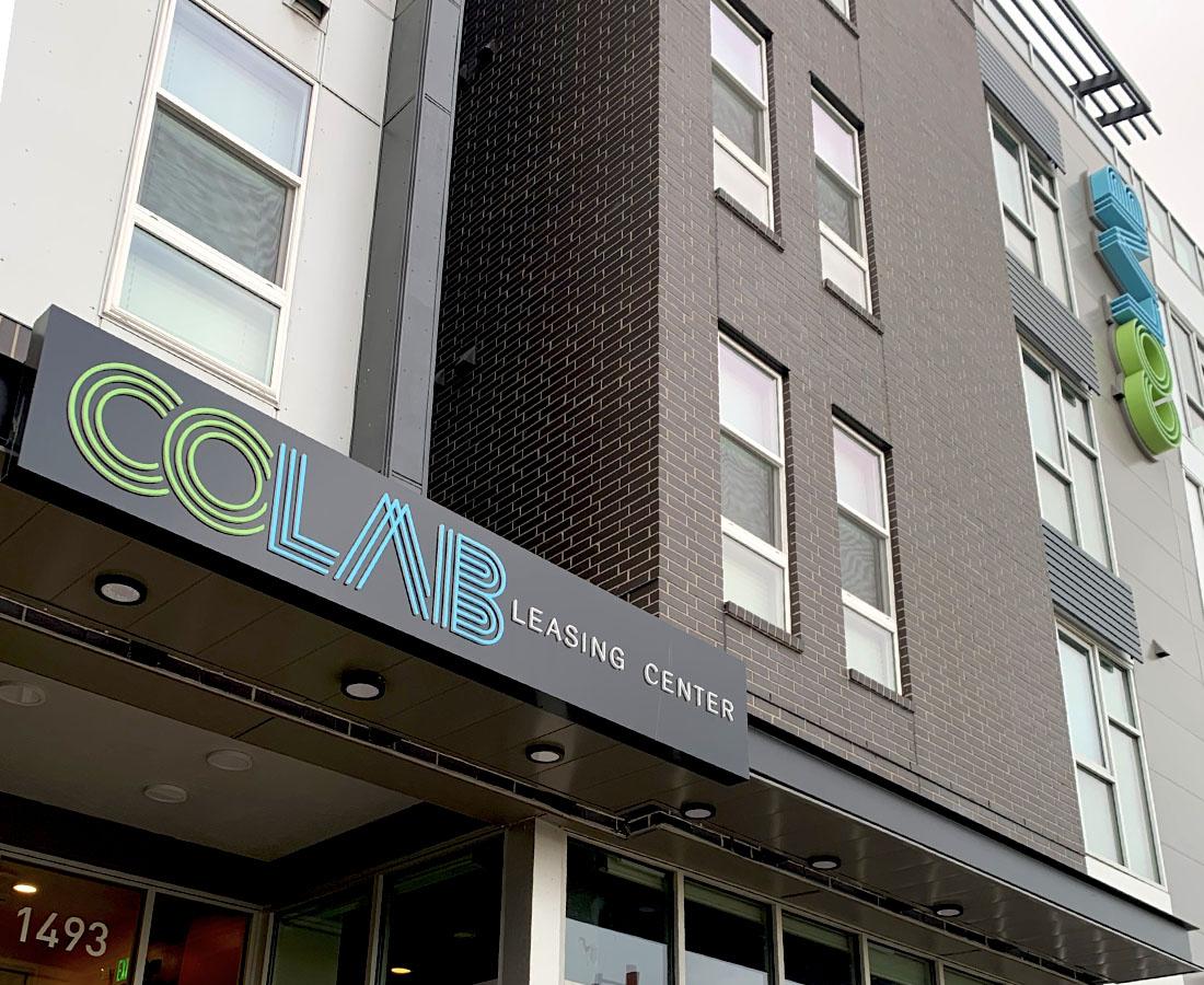Colab Apartments exterior leasing center sign