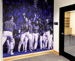 Purple Rockies player wall graphic at the Colorado Rockies Clubhouse at Coors Field