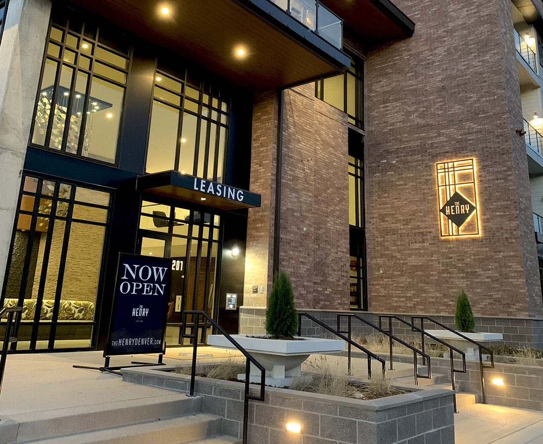 The Henry exterior signage by leasing center