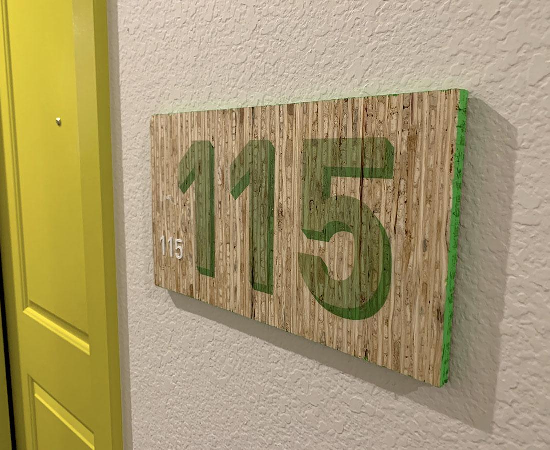 Colab Apartments interior unit ID green kirei board