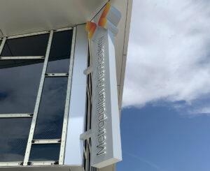 Metropolitan Arts Academy illuminated blade sign close up