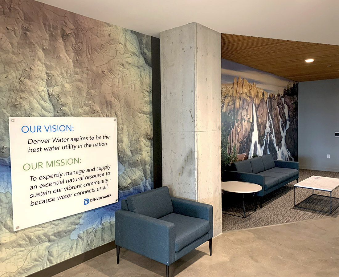 Interior murals and informational panel at Denver Water