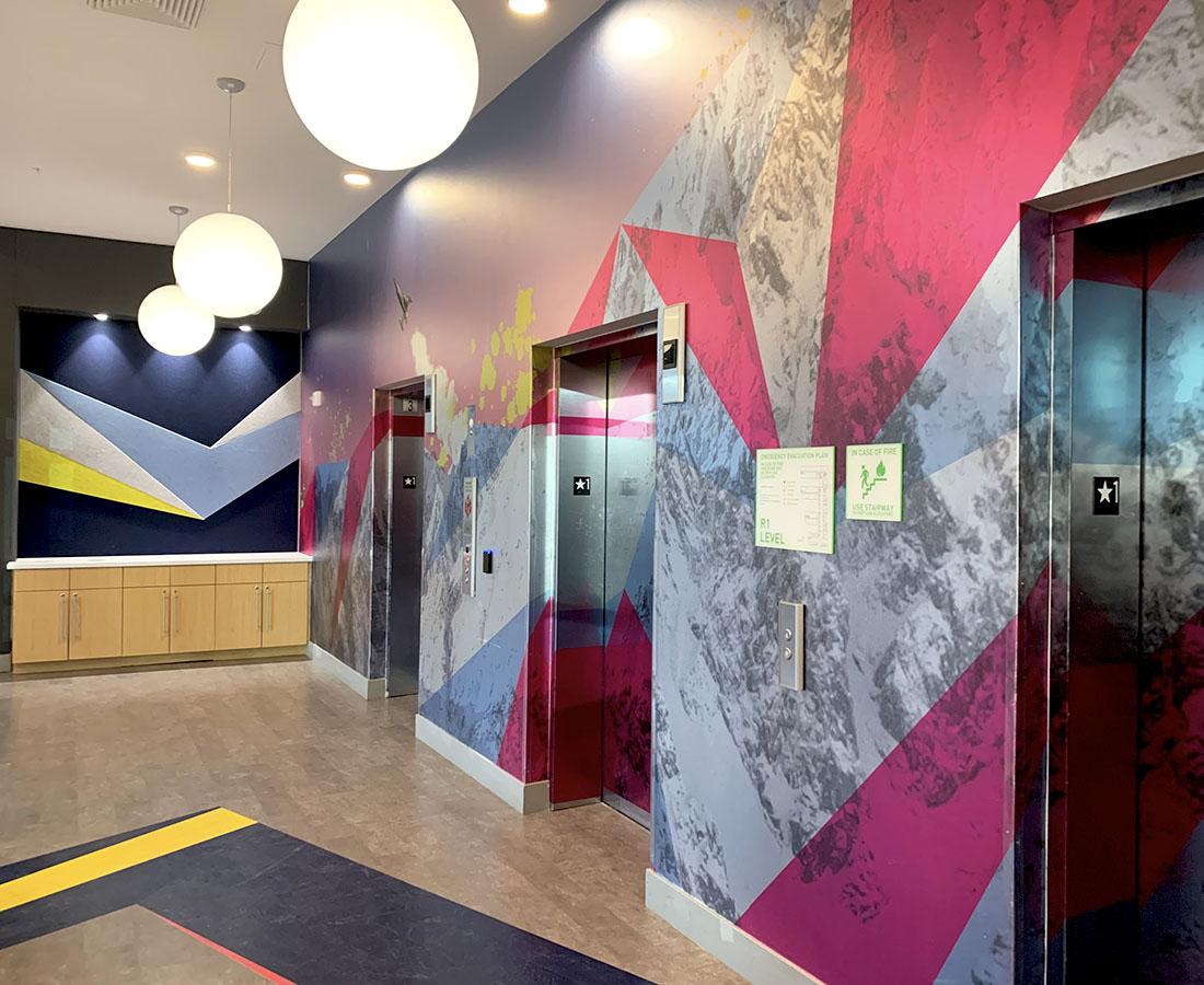 Colab Apartments interior elevator sign