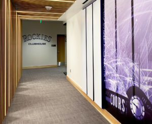 Hallway to locker room wall graphics and letterset at the Colorado Rockies Clubhouse at Coors Field