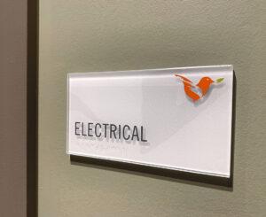 Vita Littleton electrical room ADA sign