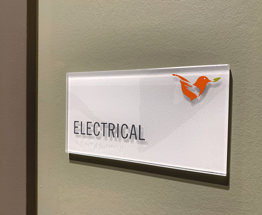 Vita Littleton electrical room ADA sign