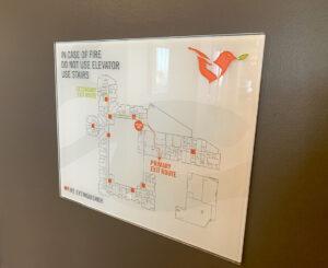 Vita Littleton interior fire exit glass sign