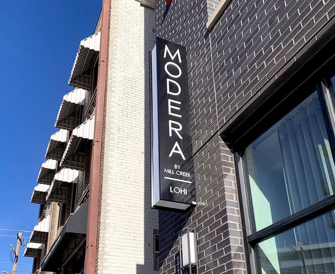 Exterior illuminated blade sign at Modera LoHi
