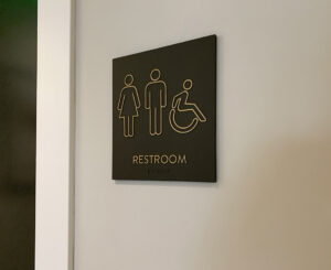 Interior restroom sign at the Fremont Residences