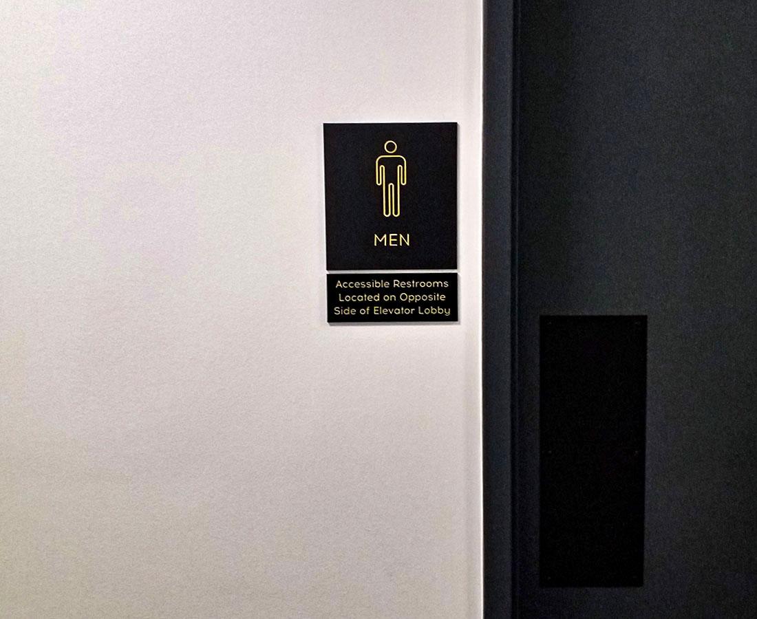 Cherry Creek Place interior restroom ADA sign