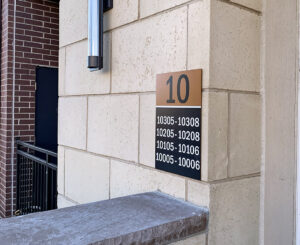 Exterior building ID sign with Unit numbers at The Palmer