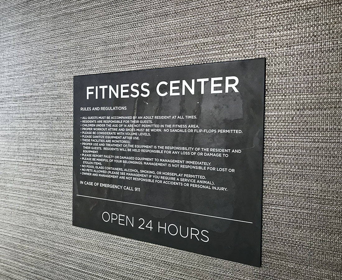 Interior fitness center sign at Alliance Residential Montane