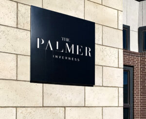 Exterior building ID with cutout letters at The Palmer