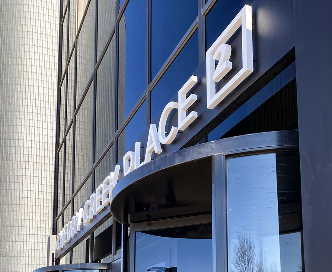 Cherry Creek Place entrance illuminated letters close up