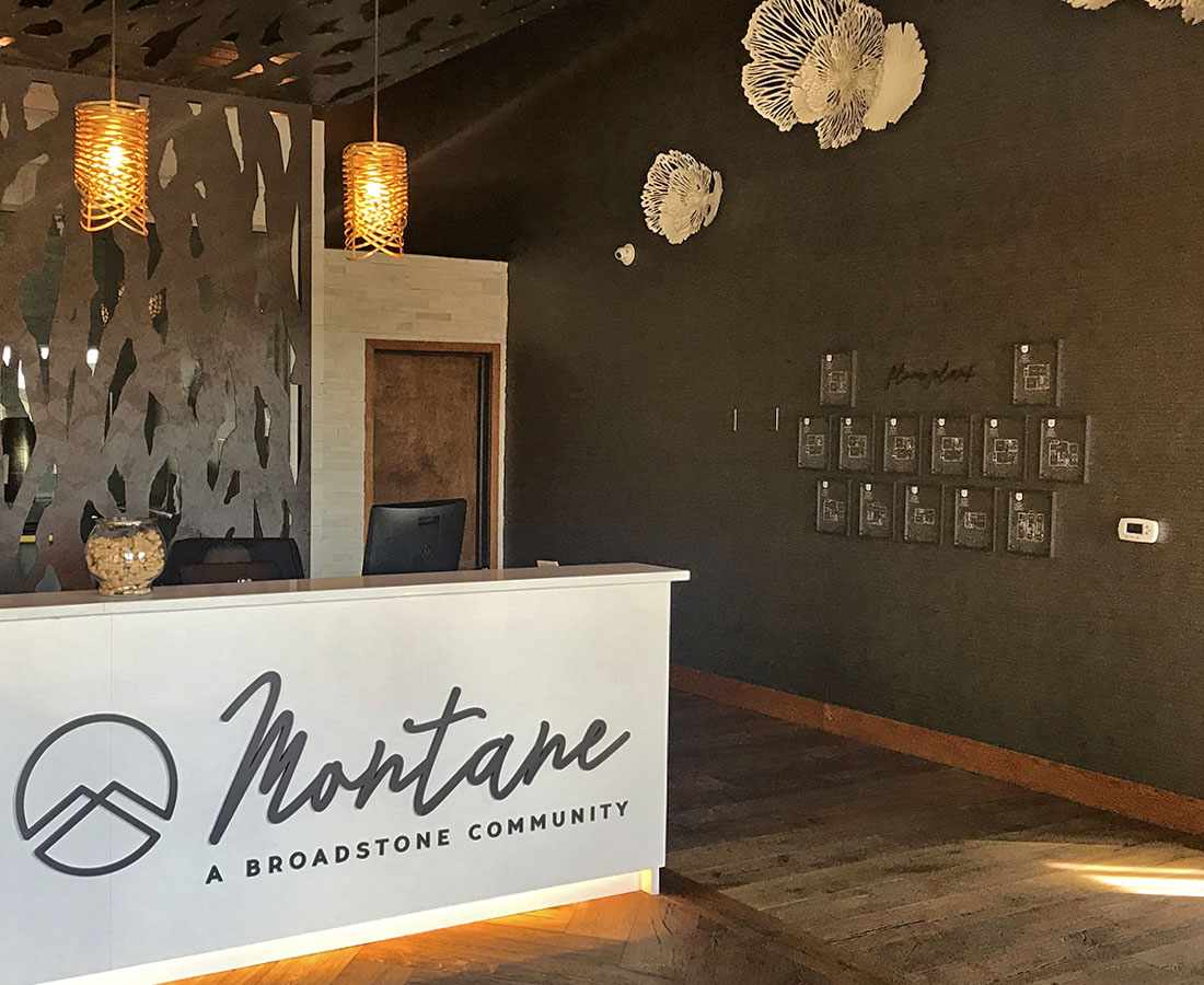 Interior leasing desk signage at Alliance Residential Montane