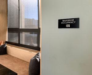 Interior capacity sign at The Palmer
