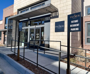 Exterior leasing, building ID, and parking sign at The Palmer