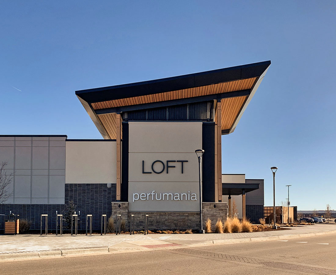 Exterior signs at Denver Premium Outlets of tenants Loft and Perfumania