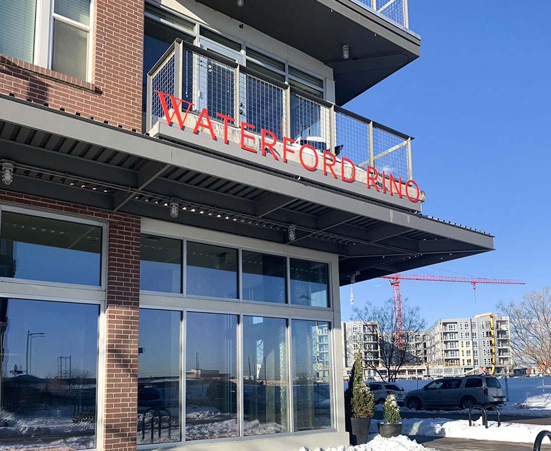 Exterior leasing address signage at Waterford RiNo