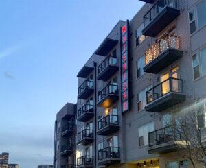 North facing address signage illuminated at night at Waterford RiNo