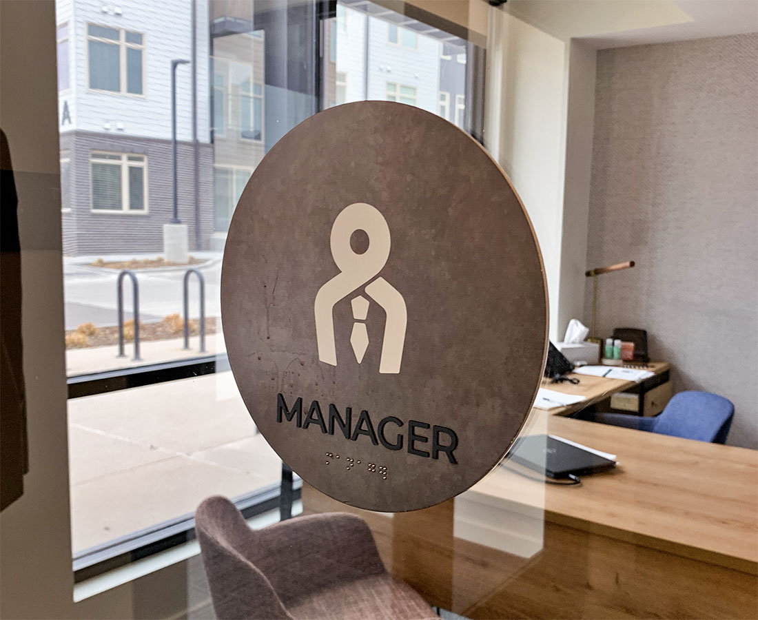 Clovis Point Apartments leasing Interior Manager ADA Sign