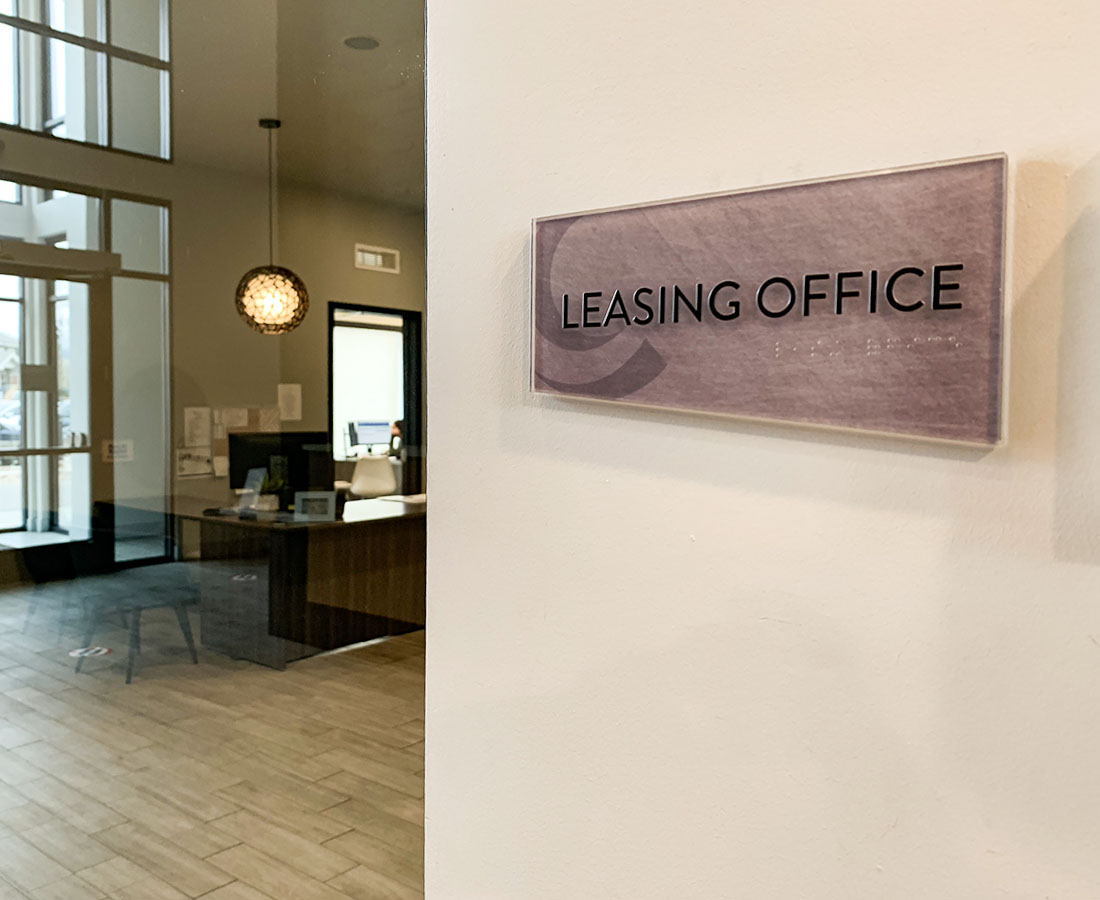 Cycle Apartments glass ada leasing office sign