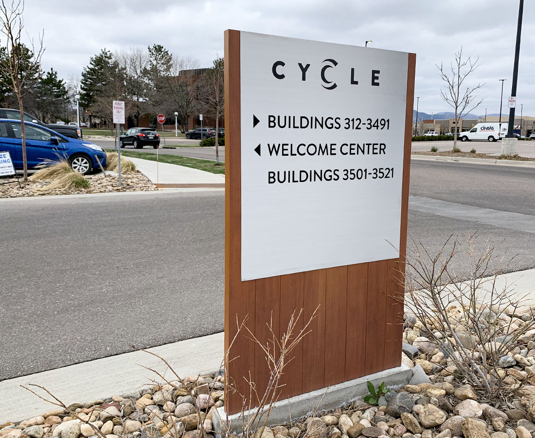 Cycle Apartments directional monument sign