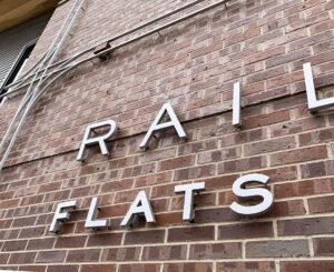 Railway Flats exterior sign close up